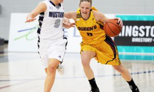 Guard Brittany Moore charges down the court while battling a Mustang player on Saturday.