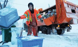 Kyle Hannah collects recyclable materials during his route through the Student Ghetto on Wednesday.