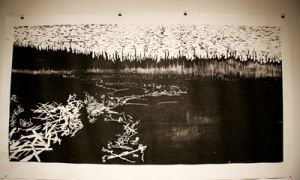 Strang's large scale woodcuts reflect isolating and humanizing time spent tree planting in northern Ontario. The scale and starkness of the prints is meant to create a sense of the overwhelming landscape.