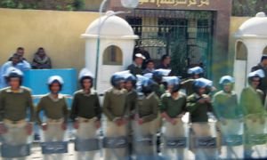 David Walker, one of 21 alumni who travelled to Egypt on a Queen's trip, photographed riot police protecting a local police station.