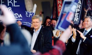 Conservative leader Stephen Harper is greeted by supporters as he arrives at Minos Village Restaurant in Kingston.