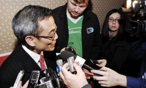 Liberal Ted Hsu talks to reporters after being elected MP for Kingston and the Islands on Monday night.