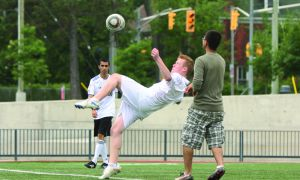 A summer intramural player attempts a bicycle kick during a game at Tindall field last week.