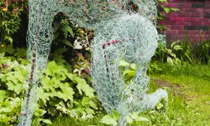 Katie Strang's Settle uses chicken wire to create three athletes. They represent the struggle students feel when finding their place in the world after finishing school.