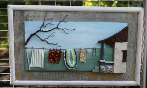 Local artist Penny Gorman makes her architectural-folk art from recyclable materials including broken shutters and pieces of old hardware.