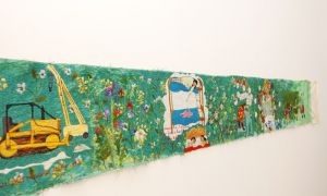 Rebecca Soudant's husband created the metal-scrolling device that kept her tapestry intact.