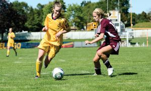 Riley Filion runs past an Ottawa Gee-Gees defender during the Gaels' 1-0 win on Saturday.