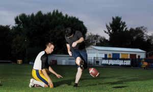 Fifth-year student Nick Green (right) is a quarterfinalist in the Wendy's Kick for a Million challenge in Toronto on Saturday. He practiced with Gaels' kicker Dan Village (left) during the team's football practice on Tuesday at Richardson Stadium.