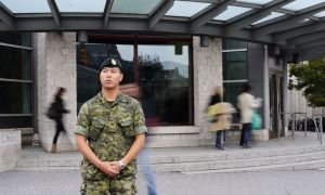 Cpl. Jeff Cho is balancing a full-time job at the Joint Signals Regiment in Canadian Forces Base Kingston with distance studies at Queen's.