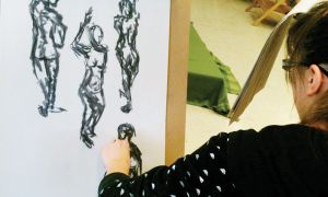 A student in the Art & Design Foundation Program at Loyalist College sketches undraped model Bonita Summers.