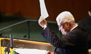Palestinian Authority President Mahmoud Abbas holds a copy of the letter requesting Palestinian statehood on Sept. 23 at UN headquarters in New York City.