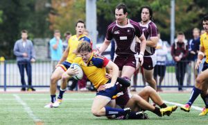 Captain Man Moor gets tackled during the Gaels' 43-3 win over the McMaster Marauders at Tindall field on Sept. 24. The two teams meet again in an OUA semifinal at Tindall tomorrow.