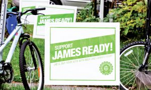 Mock-campaign signs in the Student Ghetto are part of a full-year promotional campaign by beer company James Ready.
