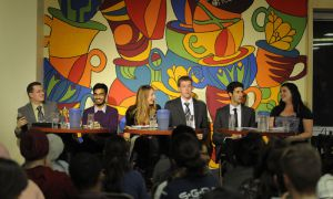 The six candidates discuss the rector's role at the debate in Common Ground on Wednesday night to a crowd of approximately 65 students. From left to right: David Myers, Asad Chishti, Robyn Laing, Mike Cannon, Nick Francis and Laura Stairs.