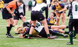 Forward Kayla Roote barely crosses the line to score a try as time expires in overtime.