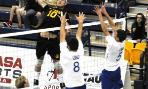 Alberta Golden Bears outsider hitter Taylor Hunt attempts a kill during the gold medal game at the ARC on Sunday.