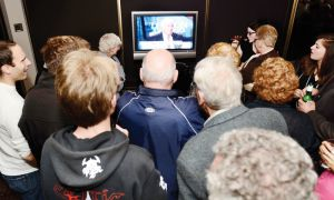 Supporters gather around the TV at John Gerretsen's campaign office in Kingston on Oct. 6.