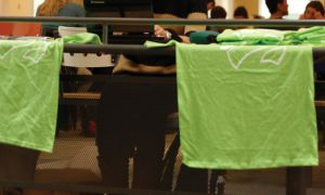 Queen's Wears Green t-shirts are being sold at several locations around campus this week.