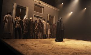Smita Misra looks to the audience in the opening scene of Dust. She plays Bibi, a widowed Pakistani woman and mother of a Taliban soldier during the play's dress rehersal on Wednesday night.