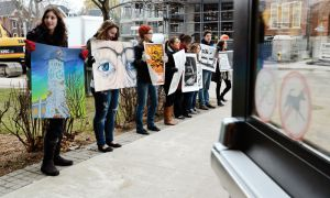 Fine Arts students congregrate outside the Robert Sutherland building on Tuesday to protest the recent decision to suspend admissions to the Fine Arts program.
