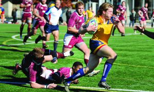 Captain Dan Moor runs in the men's rugby team's 32-10 semifinal win over McMaster last weekend.