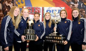 From left to right: Jessie De Boer, Mikyla Kay, Chantel Marson, Kelli Chamberlain, Chantal McFetridge and Riley Filion pose with the OUA and CIS trophies. The women's soccer team won their second-straight national title in Montreal on Sunday.