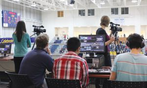 The Queen's TV team webcasts a varsity game at the ARC. Since signing a $4,000 contract with Queen's Athletics in November, QTV has webcast seven varsity games and will webcast four more.