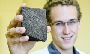 Craig Herring, Sci '12, holds an oil deposit sample from the department of geology's collection.