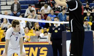 """University of Calgary's 7'1 middle hitter Ivan Kartev (right) has been turning heads this weekend for his height. Dinos head coach Rod Durrant says the team plays better when Kartev blocks well: """"If he takes up space, we can play defence around him."""""""