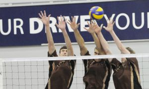 The Manitoba Bisons block a play at the 2012 CIS men's volleyball championship.