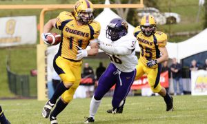 Giovanni Aprile eludes a Laurier defender during Queen's 58-35 win on Sept. 17, 2011.