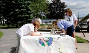 Attendees at World Suicide Prevention Day in Kingston were invited to write inspirational quotes or poems on a banner.