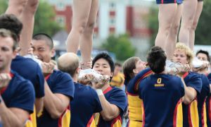 Eleven members of the Queen's cheerleading team are males.