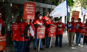 Local teachers demonstrated outside of Premier Dalton McGuinty's talk held at the Holiday Inn.