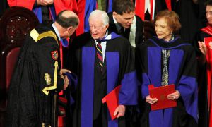 Jimmy Carter told graduates to reach out to those in need if they're able to.