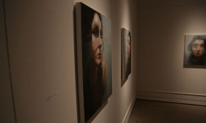 BFA student Monika Rosen's exhibit brings up themes of questioning self-identity by blurring out the subjects' faces in her oil paintings.