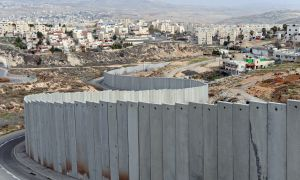 In the ongoing conflicts between Israel and Palestine, a security barrier has been erected dividing the landscape.