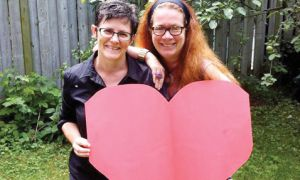 Susan Belyea, left, and Karen Dubinsky, right, posing for the Kingston Loves the Queer Community Facebook page.