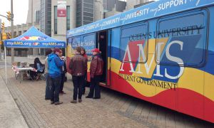 AMS Municipal Affairs Commission overseeing the Queen's Gives Back food drive, which took place Sunday.