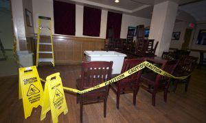 Queen's Pub closed off a section of its seating area as a result of a leak.