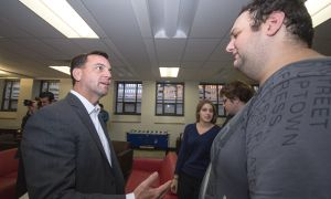 Student Kevin Wiener, right, discusses conservative policy with Tim Hudak, left.