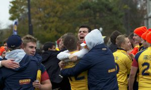 Fourth-year wing Graham Turner celebrated with his teammates after beating Western.