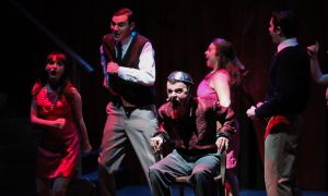 Queen's Musical Theatre's production, Assassins, a dark and comical musical, features quirky and passionate musical numbers and directing worth an applaud.