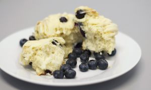 Blueberry buttermilk scones with a white chocolate glaze.