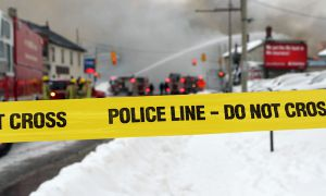 Kingston Fire and Rescue extinguishes the blaze at the intersection of Princess and Victoria Streets on Dec. 17. The cause of the fire remains under investigation.