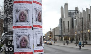 Posters accusing Adele Mercier of being a rape apologist are displayed around campus.