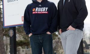Dan Moor (left) passed on the Queen's rugby captaincy to Jacob Rumball, his teammate with the Ontario Blues.