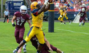 Wide receiver Curtis Carmichael hauls in the Gaels' first touchdown of the game.