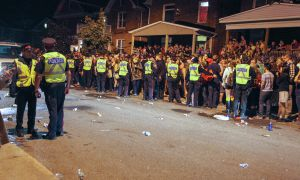 Police in the University District during the first Homecoming weekend.