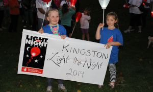Aly Davis and Camryn Hunter, both cancer survivors, led the Light the Night walk on Saturday.
